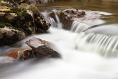 Rocks in Fast Flowing Stream