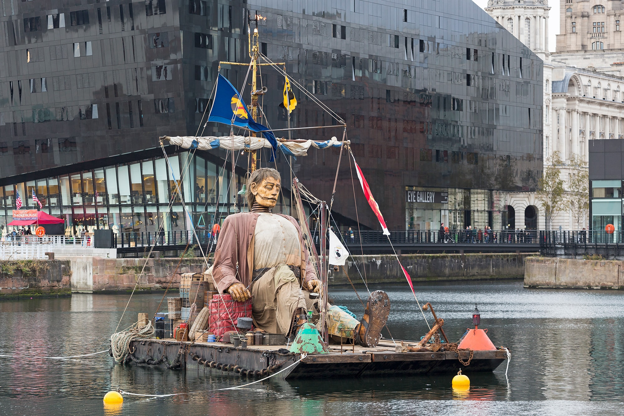 Big Giant sleeping on a raft in Canning Dock, Liverpool