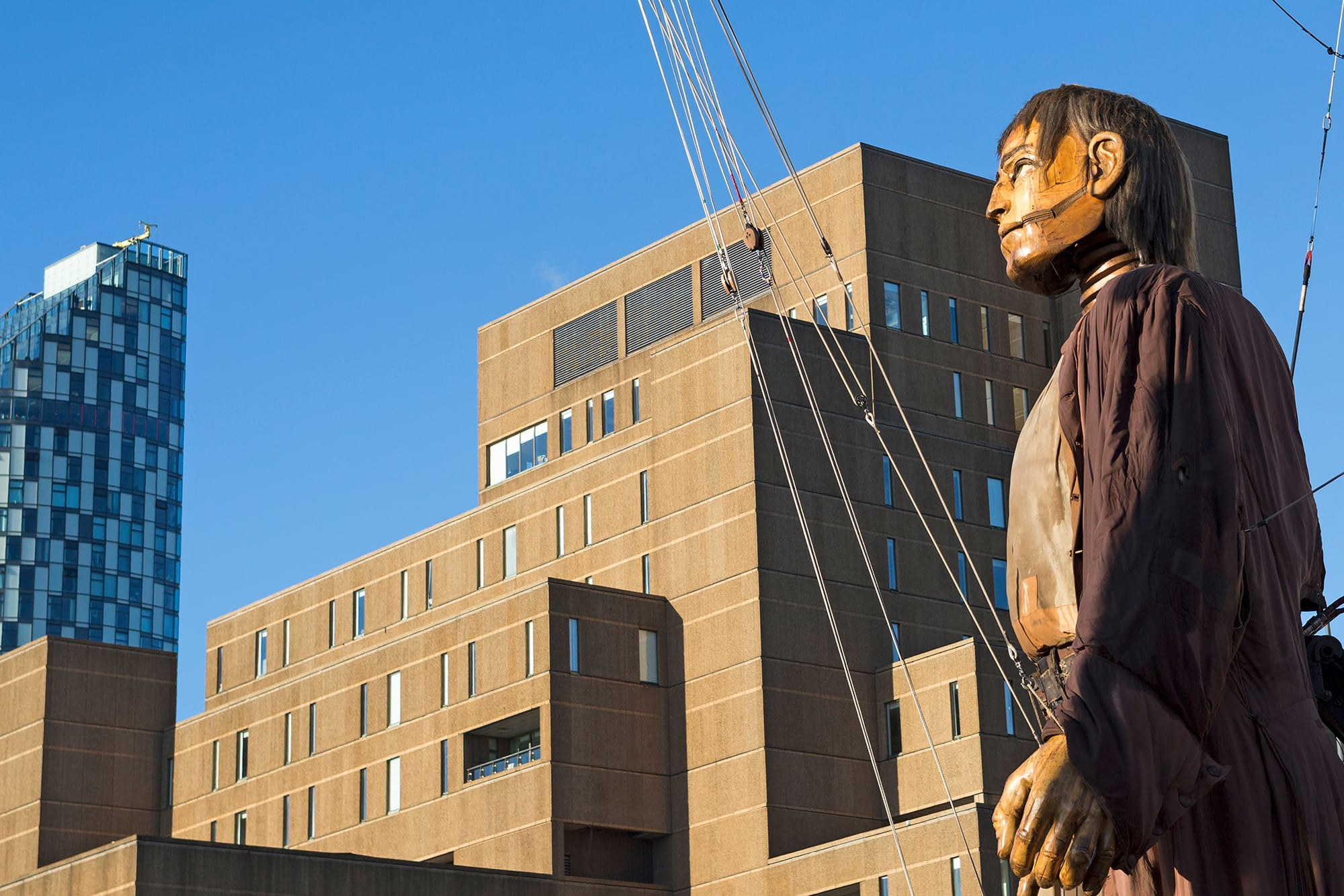 Standing as tall as buildings, Big Giant explores Liverpool