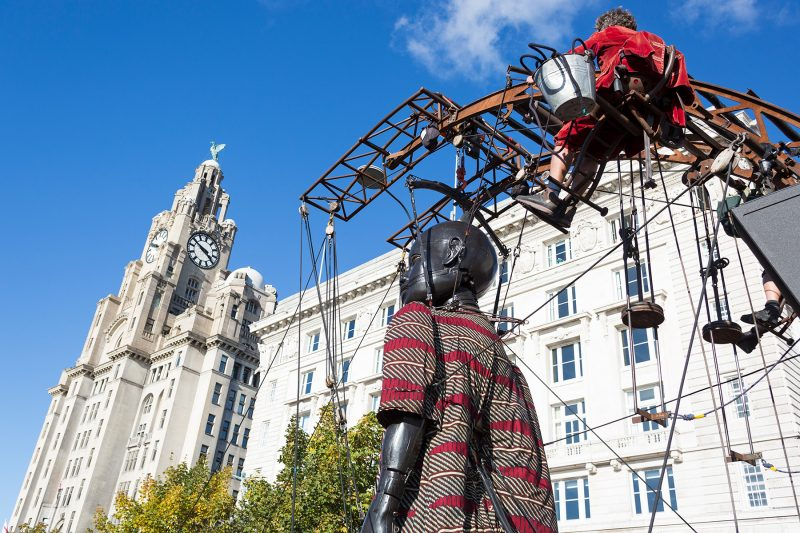 Liverpool's Dream 2018: Little Boy Giant walking past the Liver Building, Liverpool