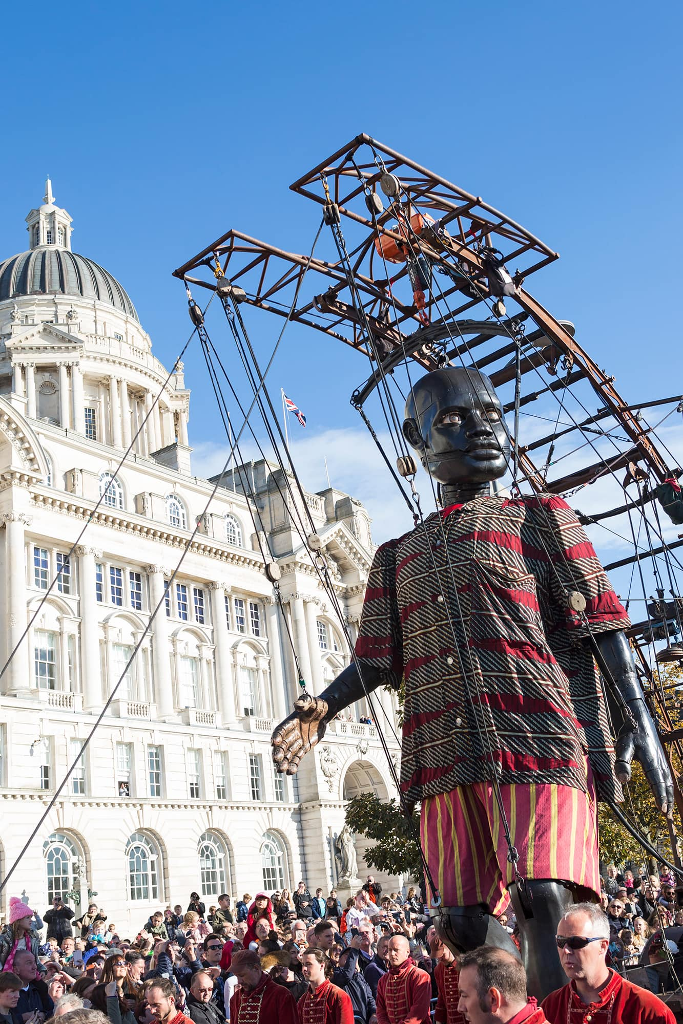 Little Boy Giant strides through the city