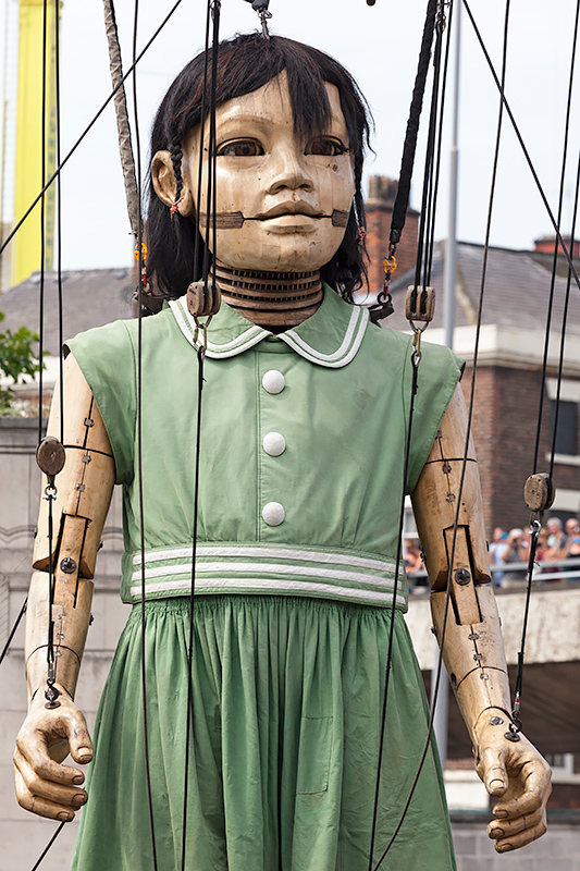 Little Girl Giant walking through the streets of Liverpool