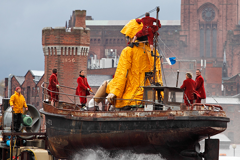 Little Girl Giant travels through Liverpool on her boat