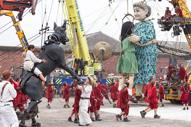 Xolo and the Lilliputians join Little Girl Giant and Grandmother for a dance in the docks
