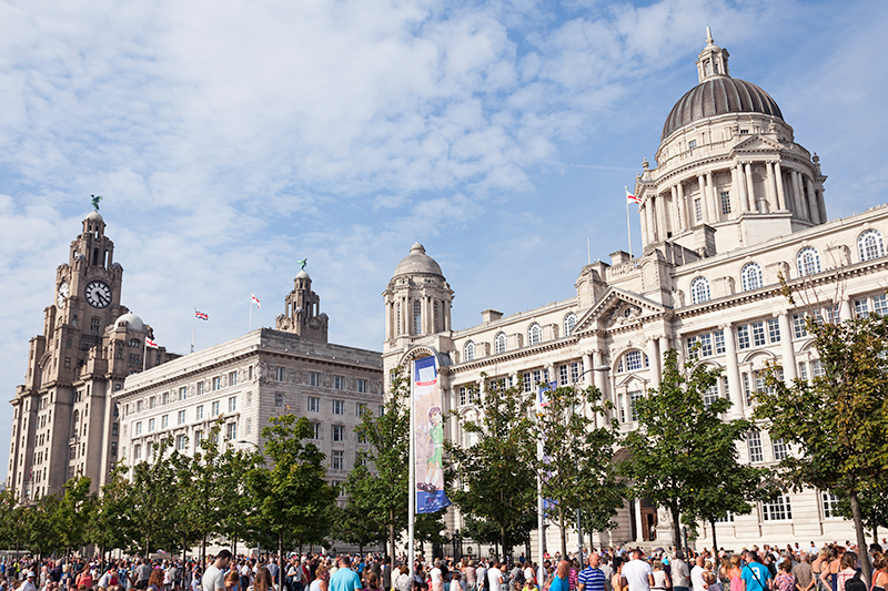 The parade passed many of Liverpool's famous landmarks including the Three Graces: Royal Liver Building, Cunard Building and Port of Liverpool Building